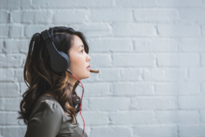 side pose of woman with headphones