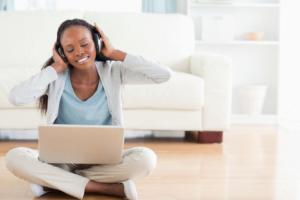 woman on the floor listening music