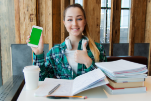 girl holding smartphone and smiling