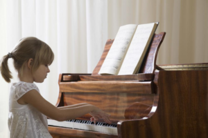 Little girl playing piano