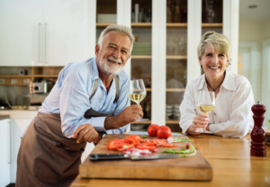old couple holding a toast and smiling