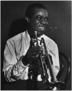 Louis Armstrong playing saxophone