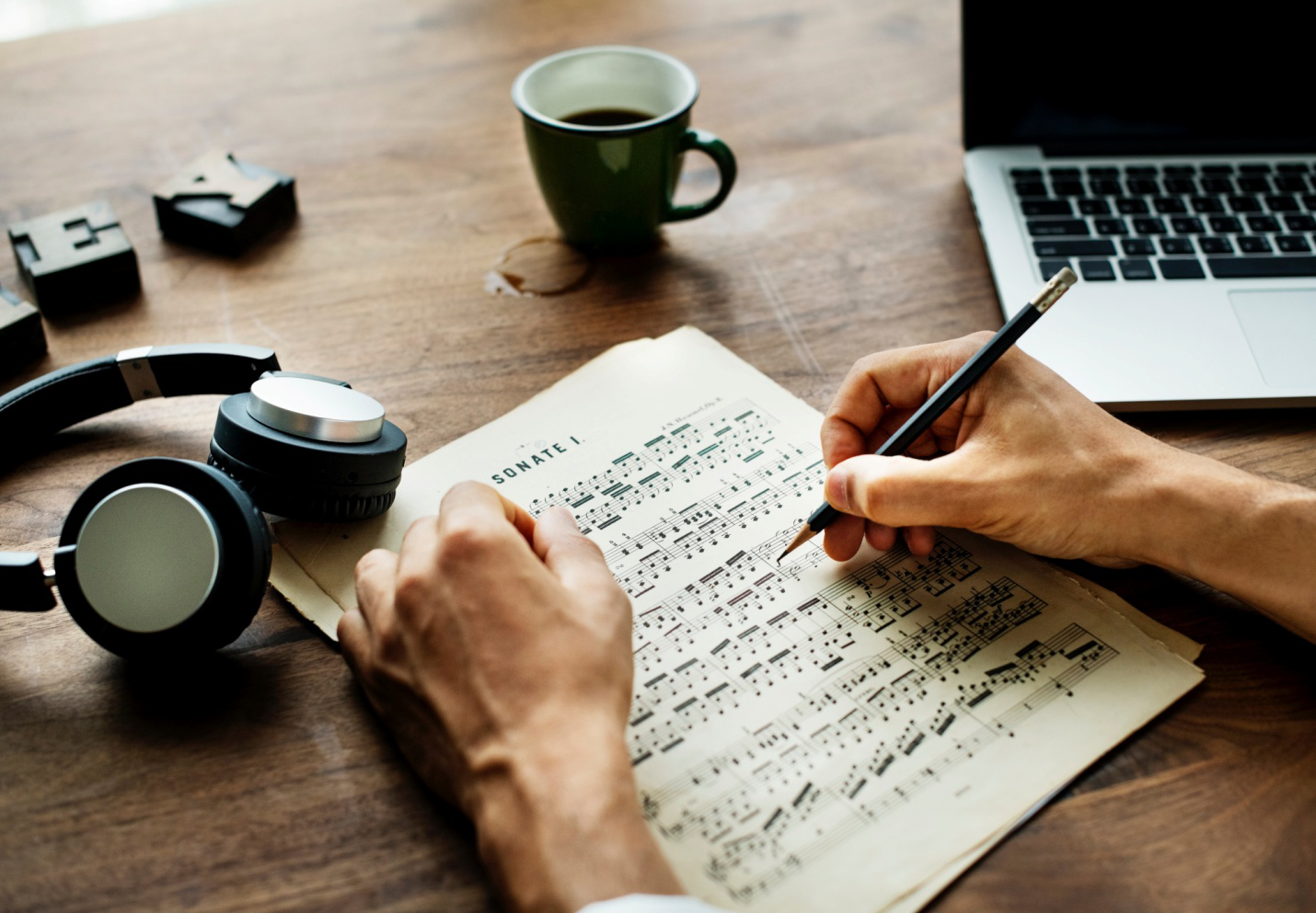 person writing musical notes