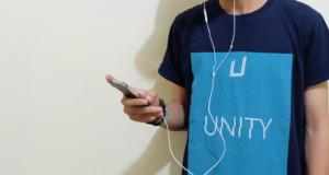 Boy wearing blue t-shirt listening to music